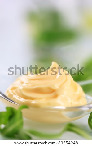Swirl of creamy sauce on a spoon  - stock photo