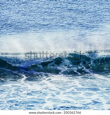 swirled blue colored ocean wave falling down - stock photo