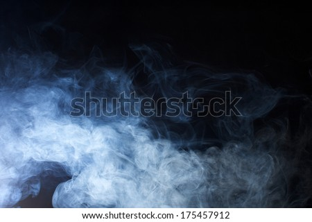 Swirling Grey and Blue Fog on Black Background - stock photo