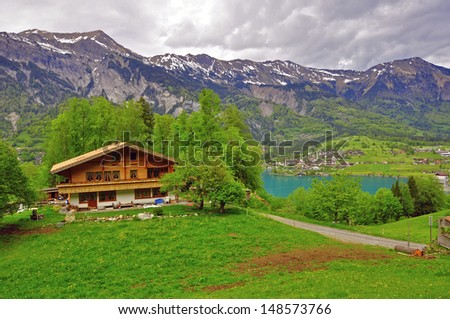 Swiss alps, chalet at the lake - stock photo