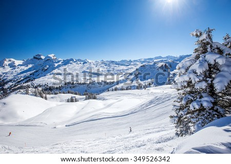 Swiss Alps covered by fresh new snow seen from Hoch-Ybrig ski resort, Central Switzerland - stock photo