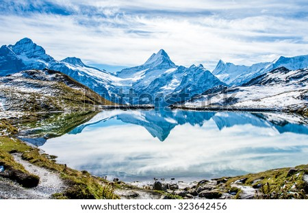 Swiss alps water reflection in  Bachalpsee - mountain lake above Grindelwald, Switzerland. - stock photo