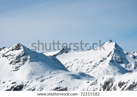 Swiss and Austrian Alps in winter, covered with snow - stock photo