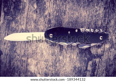 swiss army knife in the jungle - stock photo
