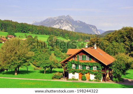 Swiss chalet in Bernese Alps - stock photo