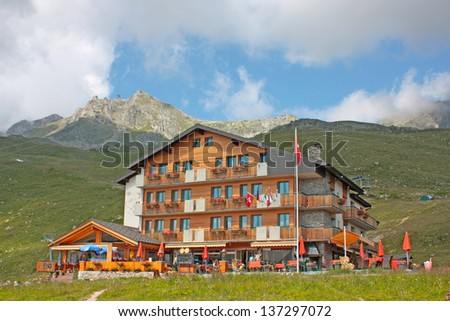 Swiss country houses in the mountains - stock photo