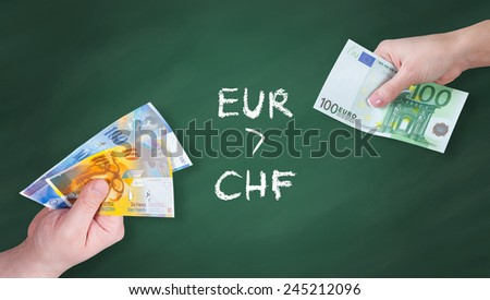 Swiss Franc and Euro banknotes on green board - Euro is stronger than Swiss Franc - stock photo