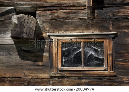 Swiss old wooden window with cobweb, excellent wooden texture - stock photo