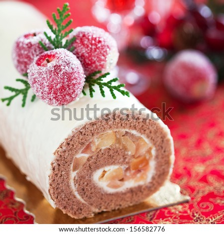 Swiss roll with cinnamon and apples, selective focus - stock photo