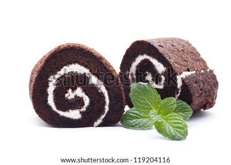 swiss rolls with green mint leaves - stock photo
