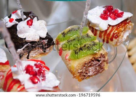 Swiss rolls with various toppings            - stock photo