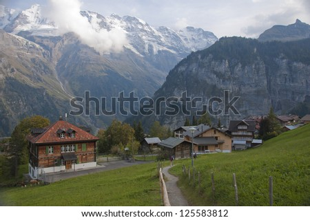 Swiss town of Gimmelwald in Alps with hiking path
