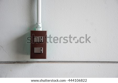 Switch On The White Wall - stock photo