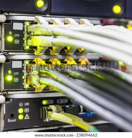 Switch ports and patch cords close up - stock photo