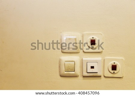Switches and sockets set on an old wall - stock photo