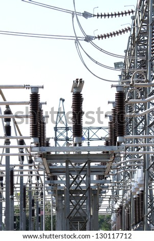 Switchgears and switches in a power plant with steel structure - stock photo