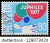 SWITZERLAND - CIRCA 1977: A postage stamp printed by Switzerland, shows balloons carrying letters, circa 1977, in Switzerland. - stock photo