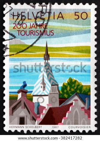 SWITZERLAND - CIRCA 1987: a stamp printed in Switzerland shows Clock Tower, Zug, German Language Region, circa 1987 - stock photo