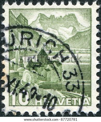 SWITZERLAND - CIRCA 1942: A stamp printed in Switzerland, shows the Chillon Castle, circa 1942 - stock photo