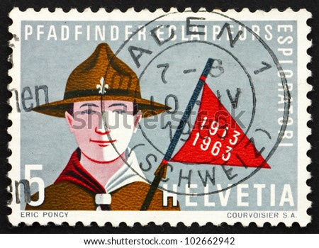 SWITZERLAND - CIRCA 1963: a stamp printed in the Switzerland shows Boy Scout, 50 years of Swiss Boy Scouts, circa 1963 - stock photo