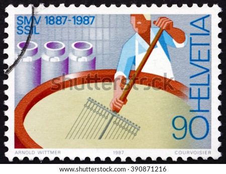 SWITZERLAND - CIRCA 1987: a stamp printed in the Switzerland shows Cheesemaker, Swiss Diary Association, Centenary, circa 1987 - stock photo