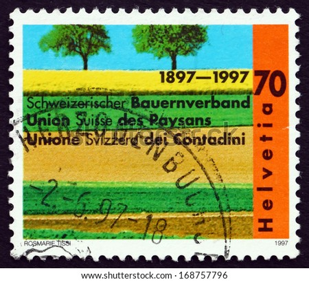 SWITZERLAND - CIRCA 1997: a stamp printed in the Switzerland shows Cultivated Fields, Swiss Farmers' Union, Centenary, circa 1997 - stock photo