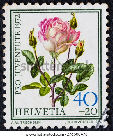 SWITZERLAND - CIRCA 1972: a stamp printed in the Switzerland shows Rose, Madame Dimitriu, Flowering Plant, circa 1972 - stock photo