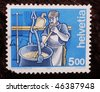 SWITZERLAND - CIRCA 1993: A stamp shows image of a man metal-casting, circa 1993 - stock photo