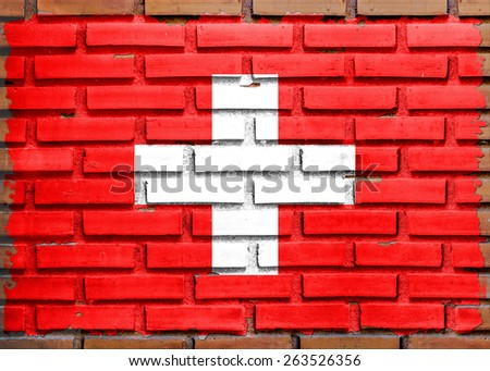Switzerland flag painted on  brown brick wall background