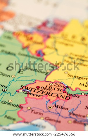 Switzerland on atlas world map - stock photo