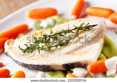 Swordfish grilled with mixed vegetables and yogurt sauce. - stock photo