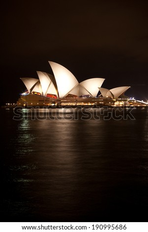 SYDNEY - APR 6: Sydney Opera House illuminated at night on April 6, 2009 in Sydney. The Iconic Sydney Opera House is a multi-venue performing arts centre also containing bars and outdoor restaurants. - stock photo