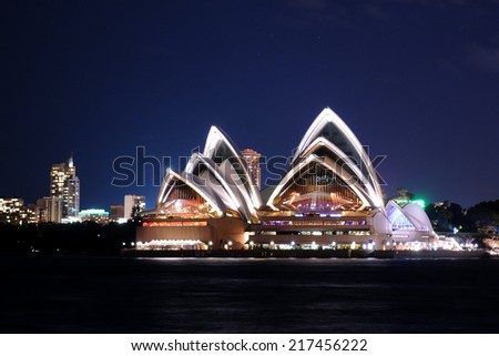 SYDNEY - August 19: The sails of the Sydney Opera House beam white at dusk on August 19, 2010 in Sydney, New South Wales, Australia. - stock photo