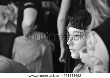 SYDNEY AUSTRALIA - APRIL 16: A model gets a fake fringe and haircut at makeup backstage during Gail Sorronda fashion show at Mercedes Benz Fashion Week in Carriageworks Sydney Australia. - stock photo
