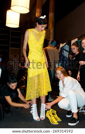 SYDNEY AUSTRALIA - APRIL 14: A model waits backstage during Ginger&Smart fashion show at Mercedes Benz Fashion Week in Carriageworks Sydney Australia. April 14, 2015 Sydney Australia. - stock photo