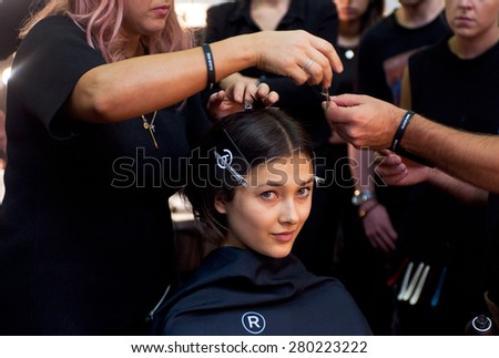 SYDNEY AUSTRALIA - APRIL 14 2015: Model has hairstyle, manicure and food during Lee Matthews fashion show backstage at Mercedes Benz Fashion Week in Carriageworks Sydney Australia.  - stock photo