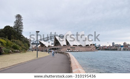 SYDNEY, AUSTRALIA - Aug. 5, 2015: Sydney Opera House is a multi-venue performing arts centre also containing bars and outdoor restaurants. - stock photo