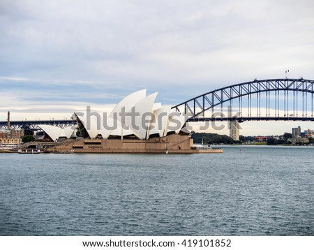 SYDNEY, AUSTRALIA - Aug. 5, 2015: Sydney Opera House viewed from Mrs Macquaire's Chair. It is a multi-venue performing arts centre also containing bars and outdoor restaurants. - stock photo