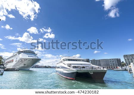 SYDNEY, AUSTRALIA - AUGUST 26, 2016: Circular Quay in Sydney harbour is the hub of the harbour ferry system. Ferries are used by commuters as a pleasant way to get into the city.