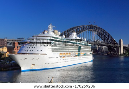 SYDNEY, AUSTRALIA - DECEMBER 1, 2013; Royal Caribbean Cruises Radiance of the Seas looking radiant in Sydney Harbour Circular Quay, Harbour Bridge in background. - stock photo