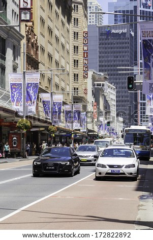SYDNEY, AUSTRALIA - JAN 4: Traffic on George Street on January 4, 2014 in Sydney, Australia. George street is one of the most important streets in downtown of Sydney. - stock photo