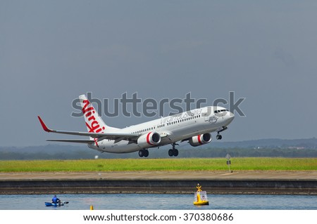 SYDNEY,AUSTRALIA - JANUARY 31,2016: A Boeing 737 of Virgin Australia takes off from the city's airport. The airport is located 5 miles south of the city centre. - stock photo