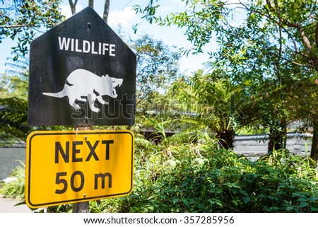 Sydney, Australia - January 11, 2014 : Directional sign pole at Taronga Zoo in Sydney. Taronga Zoo is the city zoo of Sydney, New South Wales, Australia and is located on the shores of Sydney Harbour - stock photo