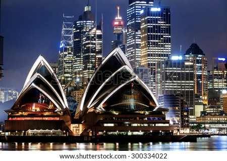 SYDNEY, AUSTRALIA - JANUARY 8, 2014: Sydney Harbour with Sydney Opera House at night. The Sydney Opera House hosts over 1,500 performances each year that are attended by more tnan 1.2 million people.