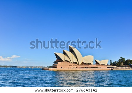 Sydney, Australia - January 25: Sydney Opera House in the afternoon on January 25, 2015 in Sydney, Australia. The Sydney Opera House is one of the most famous buildings in the world. - stock photo