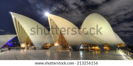 SYDNEY, AUSTRALIA- JUL 28: The Sydney Opera House on July 28th, 2012 in Sydney, Australia. The Opera House was made a UNESCO World Heritage Site in June 2007 and is Australia most famous landmark. - stock photo