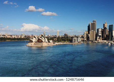 SYDNEY, AUSTRALIA - JULY 6 : A Skyline View of Sydney showing the Sydney Opera House and ferry activity taken on July 6, 2012. A multi-venue arts center designed by Danish architect Jorn Utzon. - stock photo