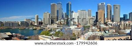 SYDNEY, AUSTRALIA - JULY 03, 2011:  Panoramic view of Sydney city and skyline with Circular Quay in the left foreground and the historic Rocks area at the right. - stock photo