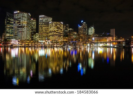 Sydney, Australia - July 12, 2010 : Sydney cbd darling harbor night scape and Reflection. - stock photo