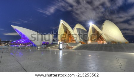SYDNEY, AUSTRALIA - JULY 28, 2012: The iconic Sydney Opera House at night in Sydney, Australia. - stock photo